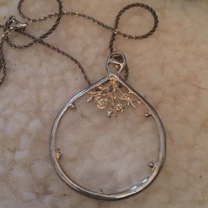 Necklace, magnifying glass